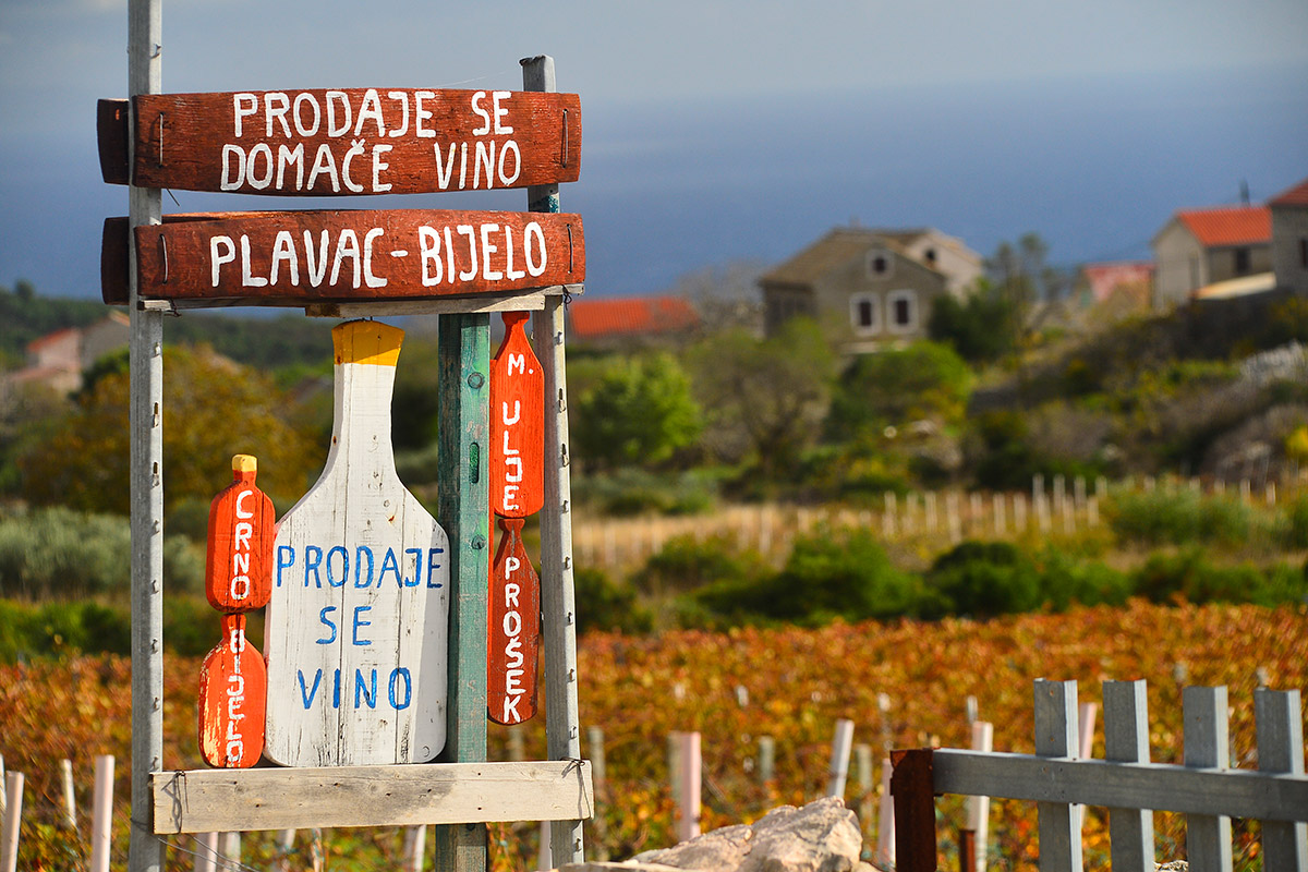 Wooden board with an inscription about the sale of wine and oil in the inland of the island of Vis