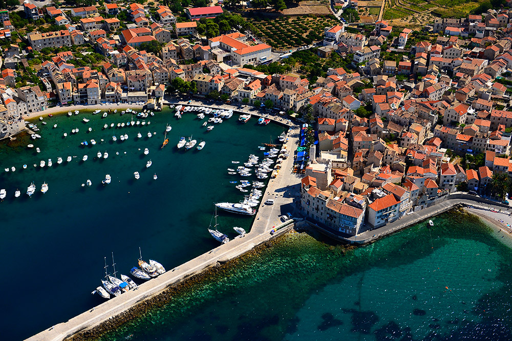 Panorama of the bay of Komiža on the island of Vis and its port with boats