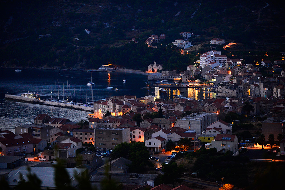 Panoramic shot of the bay of the town of Komiža on the island of Vis at night