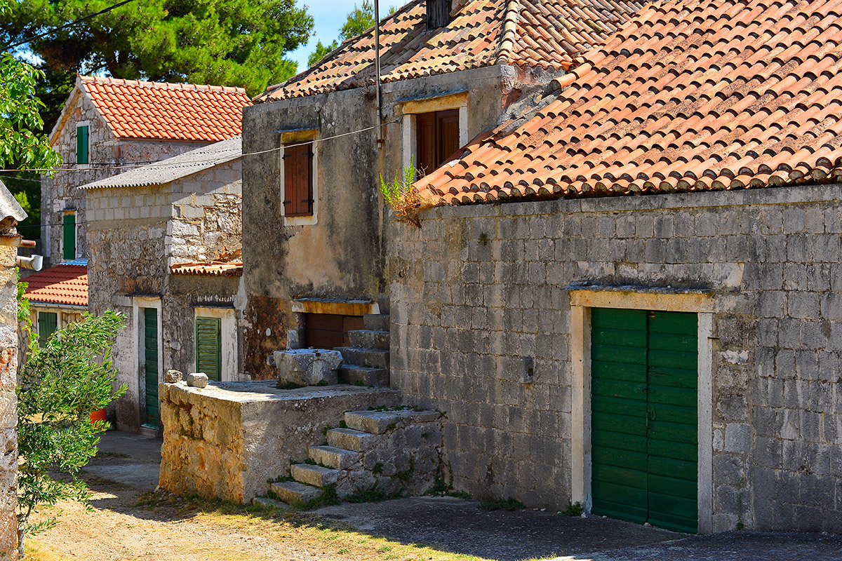 Old stone house with colorful wooden shutters