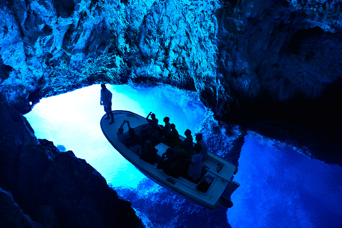 The Blue cave on the island of Biševo and a boat full of excursionists