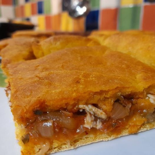 Traditional savory pie with anchovies, tomatoes, onions and olive oil from the town of Komiza