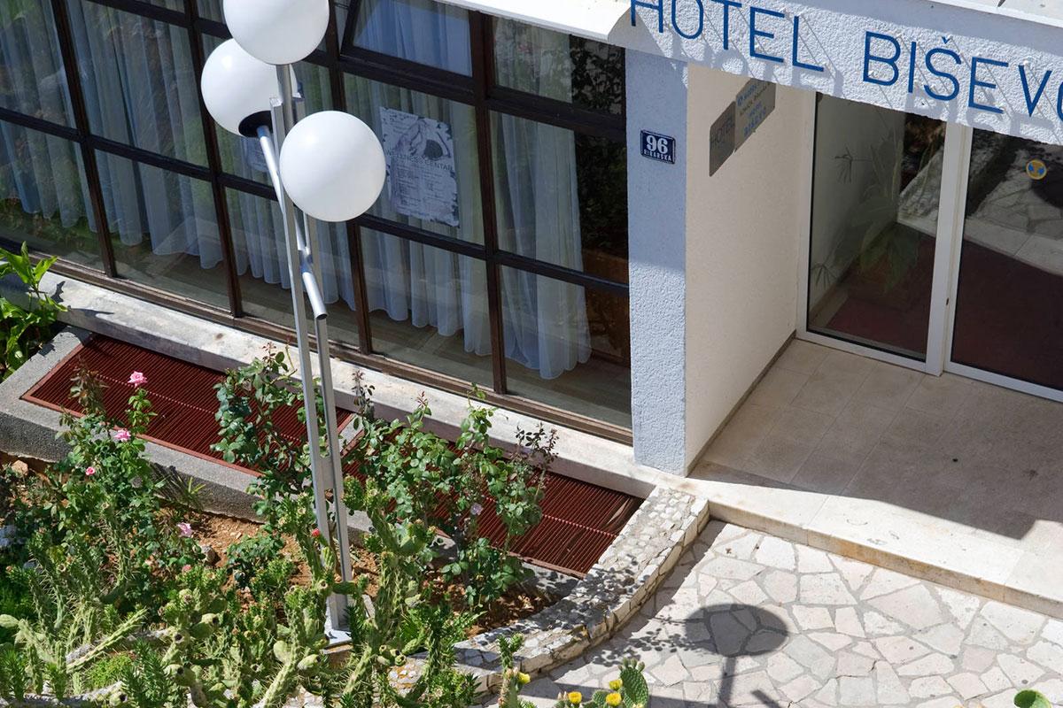 Entrance of the Hotel Biševo with a piece of Mediterranean garden