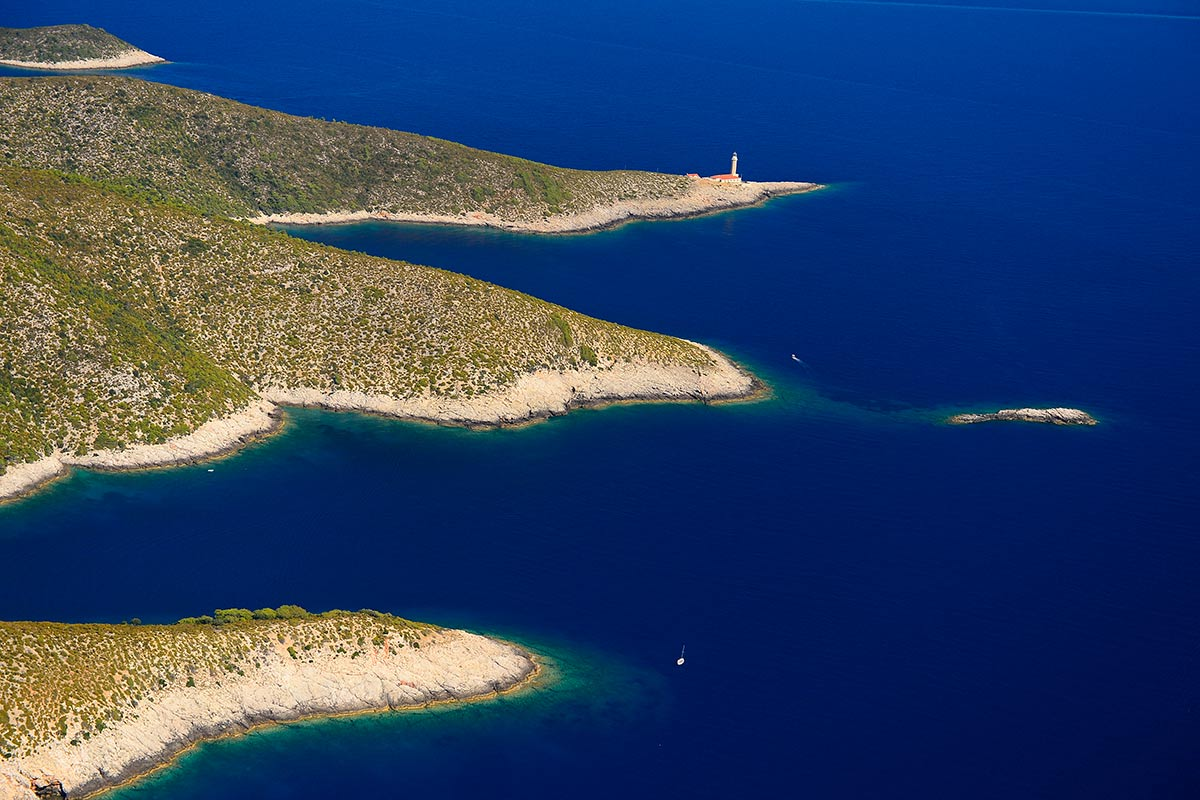 Stoncica bay and lighthouse in the blue sea of the waters of the island of Vis